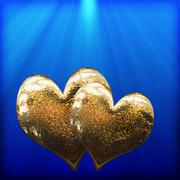 two golden hearts as a symbol of love - stock photo