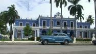 Stock Video Footage of Cienfuegos, Oldtimer in front of immigration building
