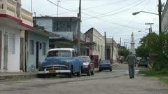 Stock Video Footage of Cienfuegos, Streetlife, Oldtimer