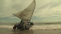 Fishermen Launching Their Boat 2 Stock Footage