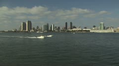 View of Two Boats On The Ocean With The City In the Background Stock Footage