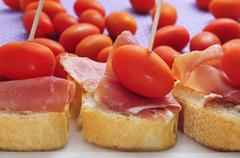 Stock Photo of spanish serrano ham sandwiches with cherry tomatoes