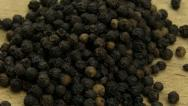 Black peppercorns Stock Footage