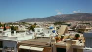Wide establishing shot and pan of Athens, Greece to reveal Acropolis and Stock Footage