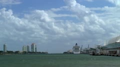 Sailing by Port of Miami.  Cruise ship at dockside. Stock Footage