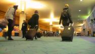 Travelers with Luggage at Airport Stock Footage