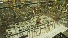 Close Up Of Gold Chains and Bracelets On Display In A Glass Case 2 Stock Footage