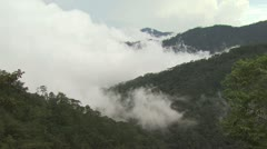 High Angle View of Fog Rising Up Through the Mountain Tops Stock Footage