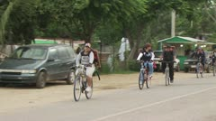 Bicycle Riders With Portraits of Christ On Their Backs Stock Footage