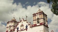 Up View of A Catholic Church In Mexico with a Cloudy Sky in the Background Stock Footage