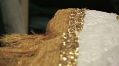 White Delicate Fabric With Gold Trim On Display At A Marketplace in Mexico. - stock footage
