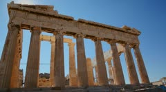 Low angle shot of the columns of the Acropolis and Parthenon on the hilltop in Stock Footage