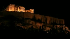 Stock Video Footage of Night shot of the Acropolis and Parthenon on the hilltop in Athens, Greece.