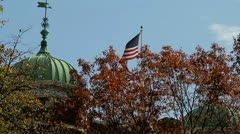 American Flag in Autum Leaves Stock Footage