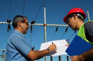 Engineer Showing Blueprint to Worker Stock Photos