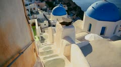 Gorgeous churches ,walkways and buildings grace the island of Santorini in the Stock Footage