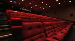 Empty cinema seats with spotlights moving Stock Footage