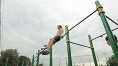 Athlete exercising on the horizontal bar Stock Footage