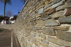 beige stone wall - stock photo