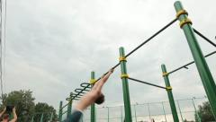 Athlete exercising on the horizontal bar Stock Footage