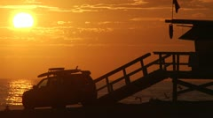 Venice Beach Sunset in Slow motion. Birds fly by lifeguard truck 0019SD - stock footage