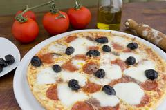 Pizza with black olives Stock Photos