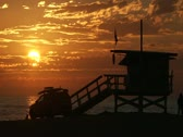 Stock Video Footage of Sunset at Venice Beach in Time Lapsed. Lifeguard tower and truck. 1