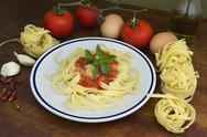 Stock Photo of tagliatelle surrounded by ingredients