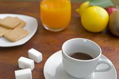 coffee with fruits and cookies - stock photo