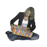 sitting girl unpacking a present - stock photo