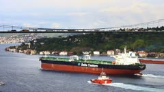Super tanker ship sailing with a pilotage service boat in Straits Bosporus Stock Footage