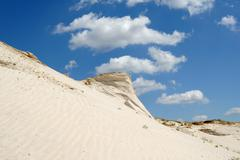 sandy mountain from white sand - stock photo
