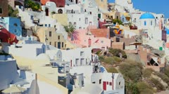 Colorful houses line the hillsides of the Greek Island of Santorini. - stock footage