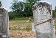 Cracked tombstone Stock Photos