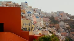 Multi colored houses line the hillsides of the Greek Island of Santorini with a - stock footage