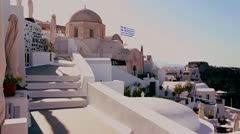 White houses line the hillsides of the Greek Island of Santorini with a Greek - stock footage