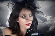 Portrait of young sexy woman in black veil on storm background Stock Photos
