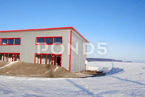 Stock photo of frozen construction among winter field