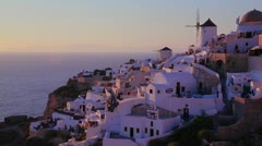 White buildings and windmills line the hillsides of the Greek Island of - stock footage
