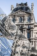 pyramid and louvre museum - stock photo
