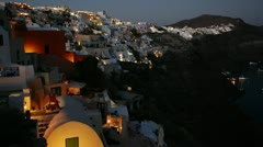 A wide shot of a village on the cliffs of Santorni in the Greek Islands at Stock Footage