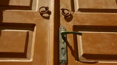 Close detail on a beautiful wooden door in a Greek village. - stock footage