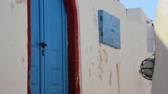 Beautiful whitewashed walls and blue doors on the island of Santorini in Greece. - stock footage