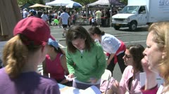 Registering marathon runners (3 of 3) Stock Footage
