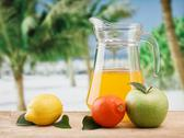 Variety of fruit and juice on a wooden table in the garden Stock Photos