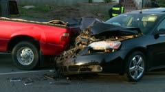 Vehicles are wrecked in a car accident on a city street. Stock Footage