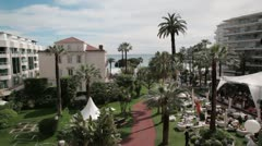 View of the square in front of Grand Hotel in Cannes, France Stock Footage