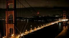 San Francisco Golden Gate Bridge at night with a star filter lens efx Stock Footage
