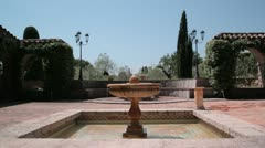 Shot of a roman style fountain in the garden of a villa Stock Footage