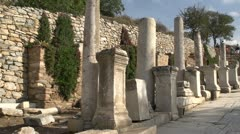 History & culture, Ephesus ruins, columns and wall wide shot Stock Footage